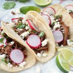 Who doesn't love Taco Tuesday?!? Take your taco game up a notch by making this easy Slow Cooker Ancho Chile Carnitas recipe for dinner tonight! Plus check out my cookbook review of The Tex-Mex Slow Cooker: 100 Delicious Recipes for Easy Everyday Meals!