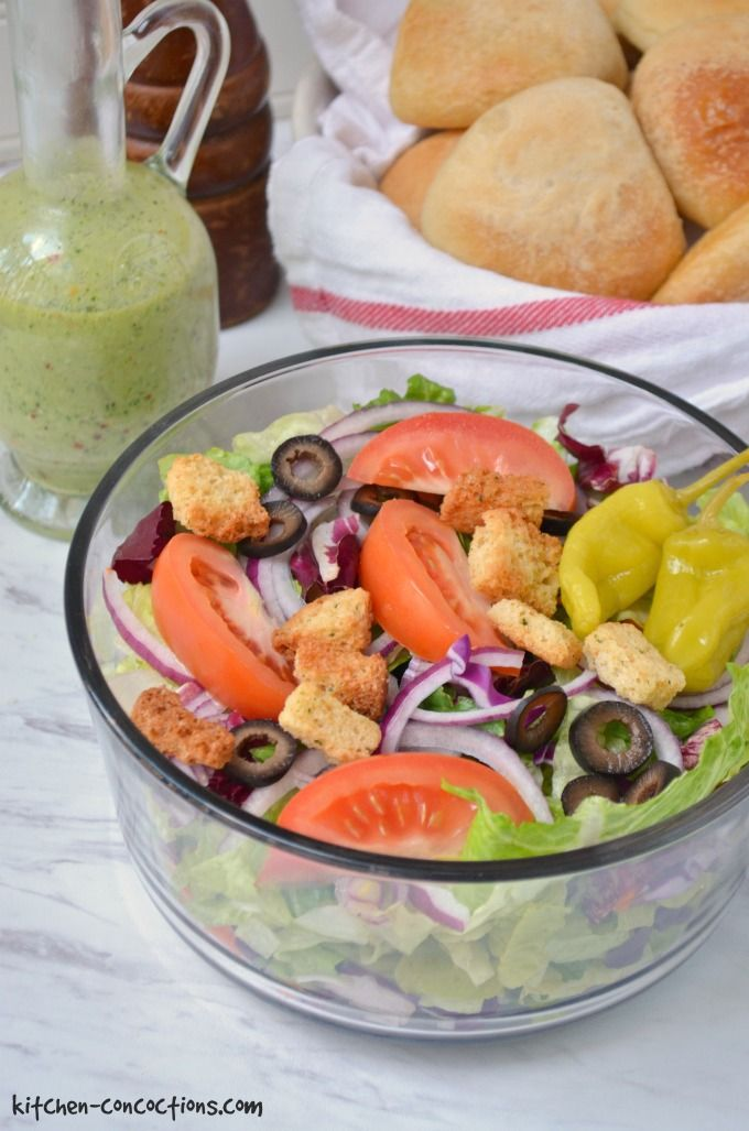 Copycat Olive Garden Salad Recipe picture with homemade salad dressing and bread