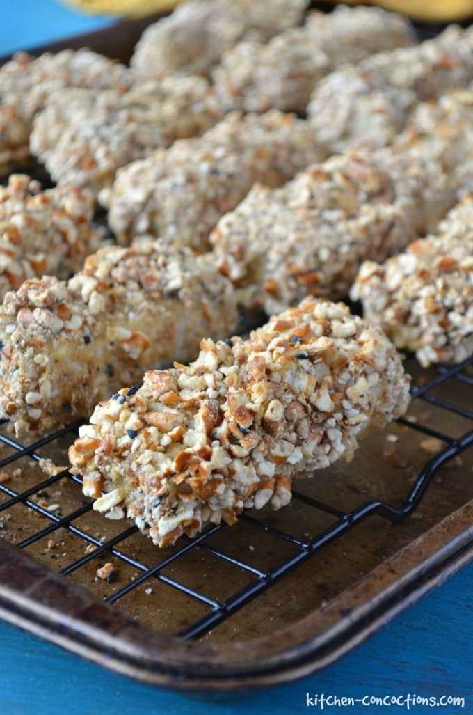 baked Pretzel Crusted Fish Sticks on a wire rack on a baking sheet