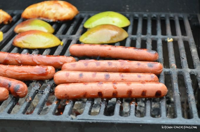 Hawaiian Hot Dogs Image - hot dogs on a grill with chicken and mango