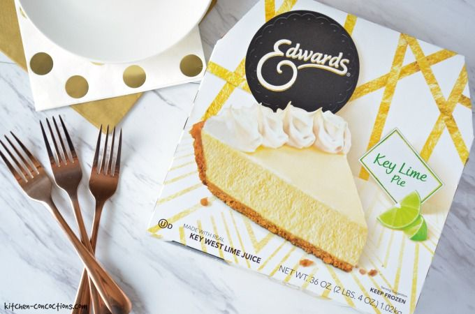 Box of Edwards Key Lime Pie with gold forks, gold polka dot napkins and white plates.