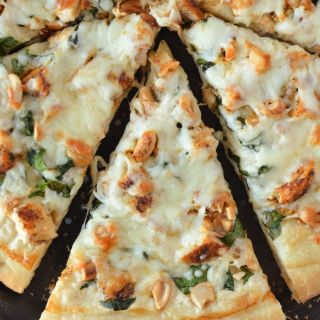 Close up photo of sliced Chicken Spinach Pizza
