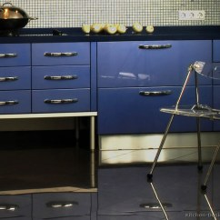 Plastic Chairs With Stainless Steel Legs Fabric Covered Oak Dining A Modern Blue Kitchen Glossy Cabinets