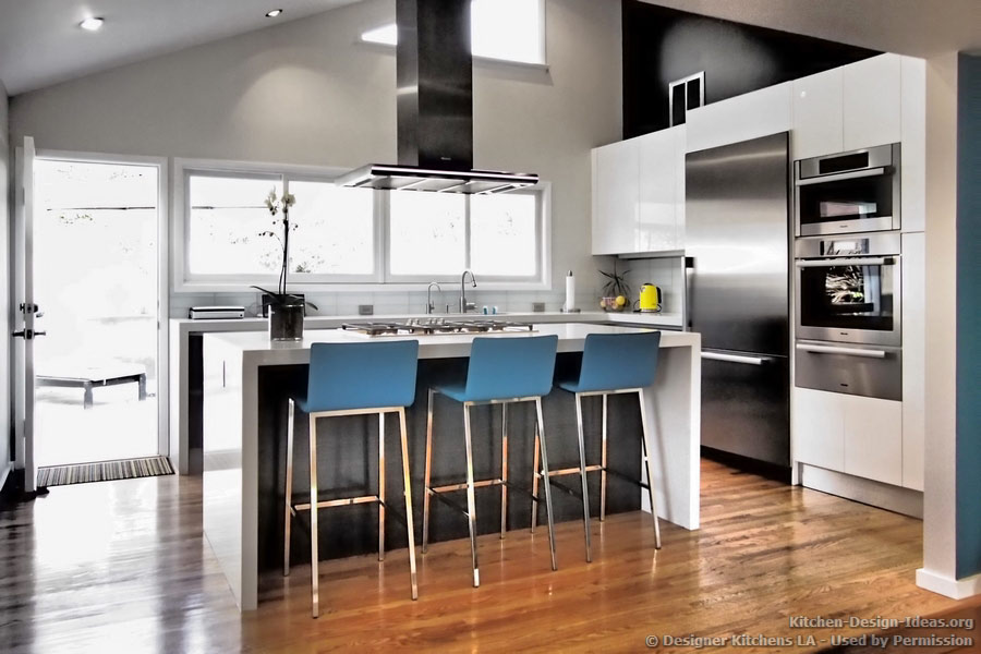 Blue bar stools provide a pop of color in this monochromatic kitchen