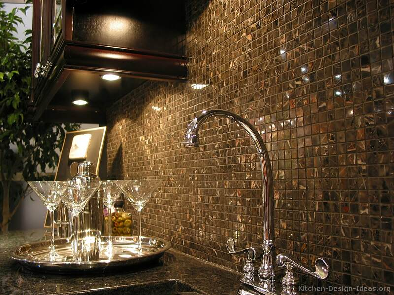 A mosaic tile backsplash featuring 5/8-inch square Michelangelo marble tiles