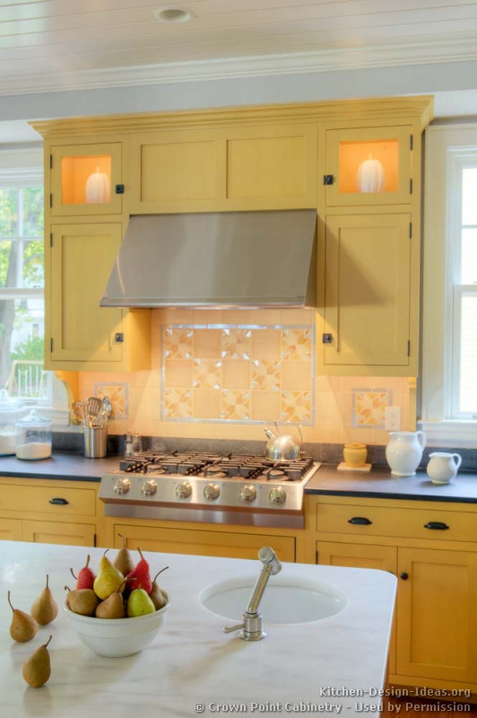 Traditional Yellow Kitchen with a Custom Wood Island