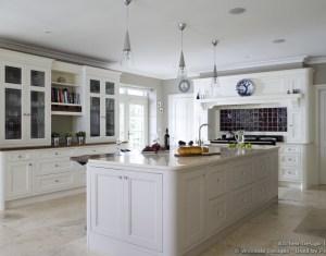 White Kitchen Cabinets And Travertine Floors
