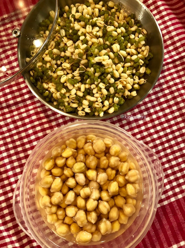Bowl of soaked whole moong dal and chickpeas