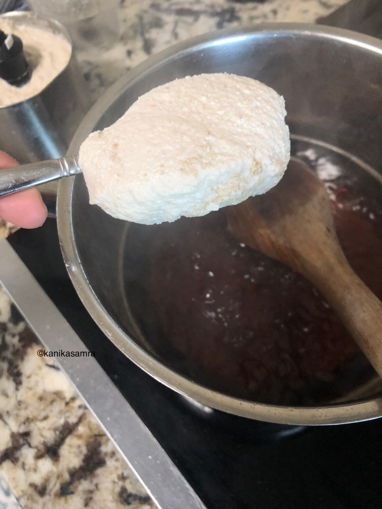 Adding ground seed paste to sugar syrup for thandai