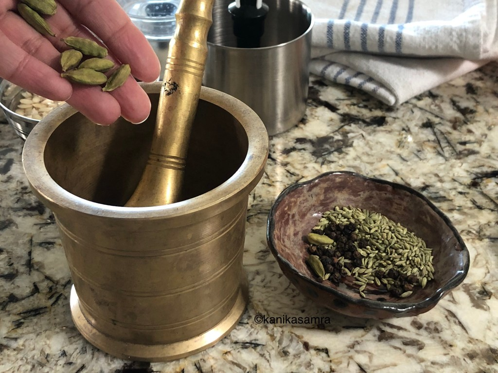 Removing cardamom seeds from the pods.