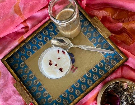 A glass of thandai on a serving tray