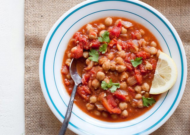 Slow Cooker Chana Masala - The classic Indian chickpea curry, Crock Pot style! So simple yet so delicious, this easy vegan dinner is on constant rotation in our kitchen.