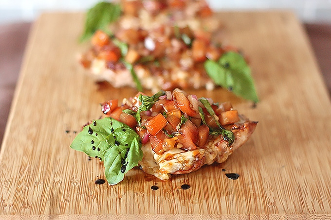 BBQ pork chops smothered with melted mozzarella cheese then loaded up with a bright and fresh tomato brushetta. One of my top 5 BBQ recipes.