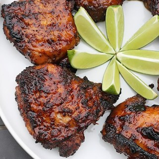 Ancho chili and tequila glazed BBQ chicken thighs. The ultimate spring dinner, and one of my top five BBQ recipes.