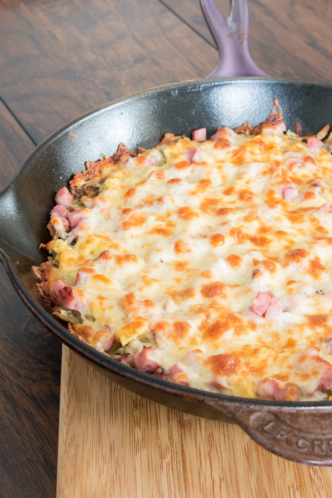 I decided to shake things up for breakfast one day and the results were amazing! You can really add anything you want, but this one has a hash-brown base with scrambled eggs, ham, and mozzarella cheese. Everyone loved it, and I managed to convince the kids it was pizza for breakfast!