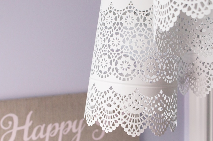 A pretty and delicate lace-like pendant chandelier made for less than $35 using three metal candle holders and a triple pendent cord set from ikea.