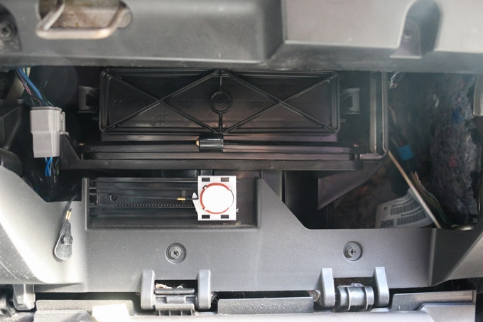 Step-by-step pictures for changing your cabin air filter and engine air filter in a Dodge Grand Caravan. Changing both takes less than 15 minutes!