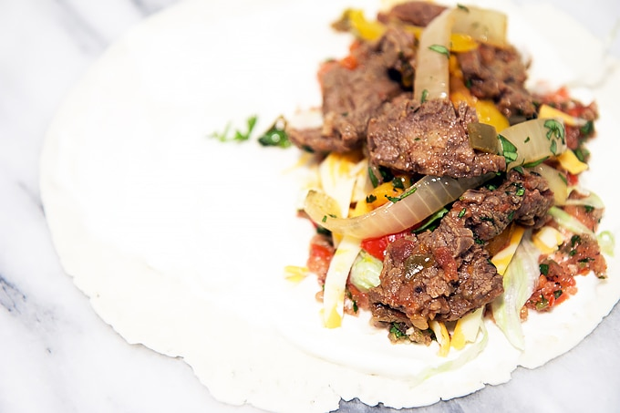 Easy slow cooker steak fajitas - just 5 ingredients and dinner is ready for you at the end of the day!