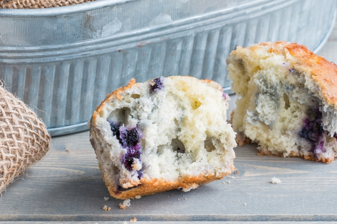 These blueberry muffins are super fluffy and made with frozen blueberries so you can enjoy them year round (fresh works too in season). Every time I make them, I get asked for the recipe from everyone who has one!