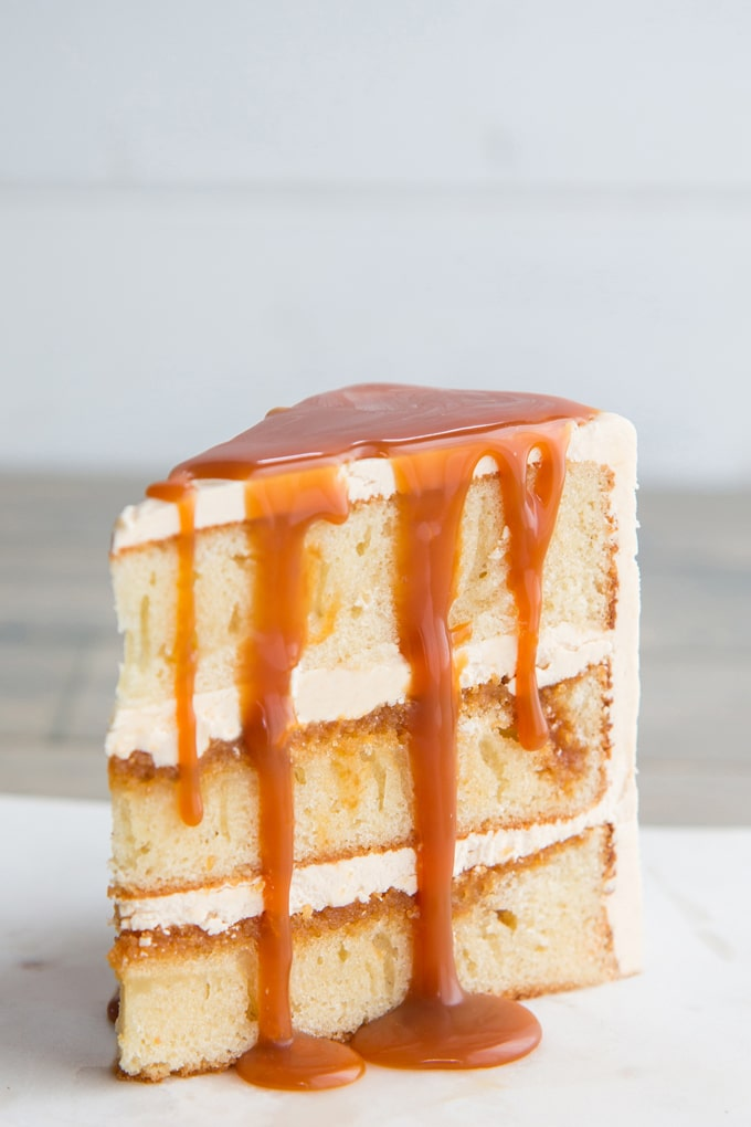 This vanilla and salted caramel cake is exactly the same as the one we spent $160 on at an upscale bakery. Moist layers of vanilla sponge cake, smothered with a homemade salted caramel sauce, and surrounded with salted caramel buttercream.