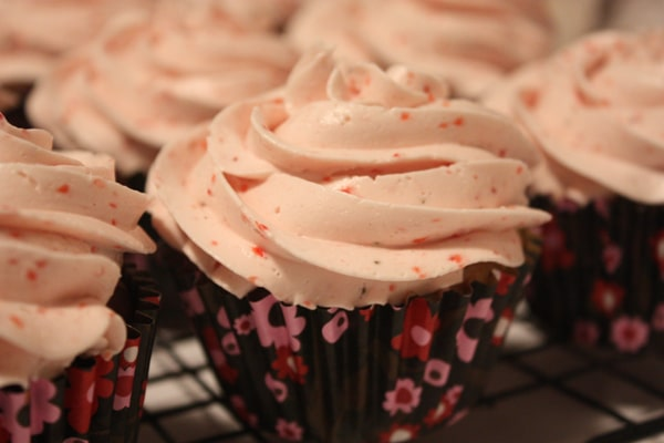 Bakery quality marble cupcakes with a fresh strawberry meringue buttercream icing.