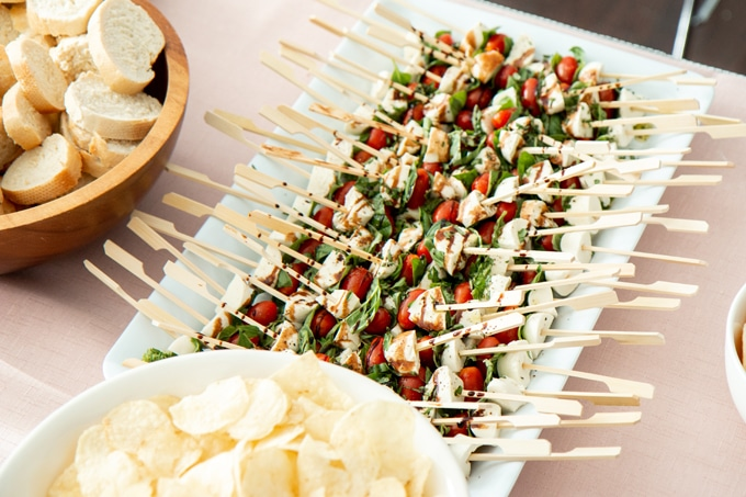 Caprese Skewers are the perfect summer snack, and they're healthy! I mean who doesn't love fresh tomatoes, basil, and cheese drizzled with balsamic glaze!