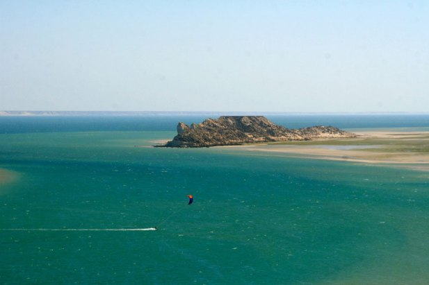 A kitesurfer at Dragon Island in Dakhla Lagoon in Morocco