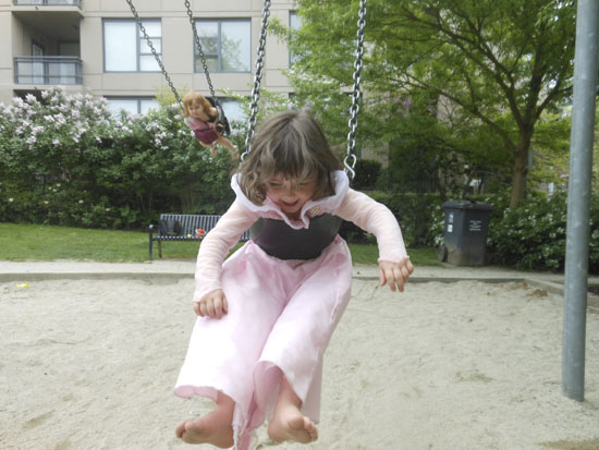 Fun on the swings at Rosemary Brown Park.