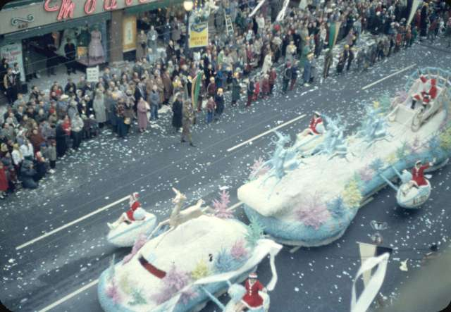 43rd Grey Cup Parade, on Granville Street, Santa and reindeer Christmas float and spectators; 1955