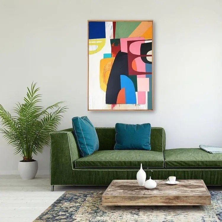 Green Living Room with Bold Artwork| Today we're talking inspiration for adding green to your living room. Green is a really versatile colour to decorate your home with. But, which colours and tones work well? What kind of accessories work with green? This post gives you ideas for pulling together an elegant green colour palette and pieces for your home. Read more: kittyandb.com #greenlivingroom #greencolorpalette #colourfulhomedecor #interiordecoratinginspiration #greenaesthetic #greensofa #artwork #wallart