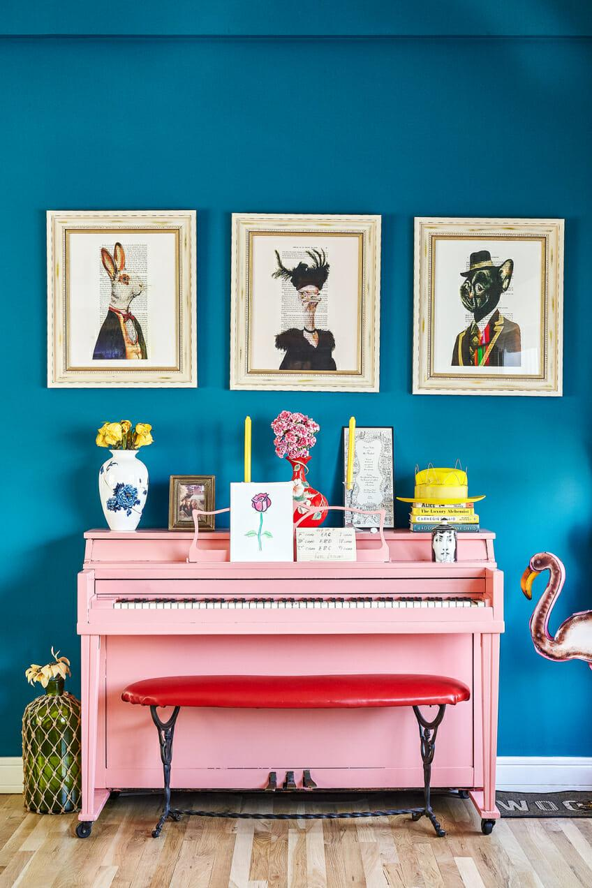 Blue Wall and Pink Piano Colourful Room Decor | Blue is a really versatile colour to decorate your home with. But, which colours and tones work well? What kind of accessories work with blue? This post gives you ideas for pulling together an elegant blue colour palette and pieces for your home. Read more: kittyandb.com #bluewall #colourfulhomedecor #colorpalette ##interiordecoratinginspiration #pinkaesthetic