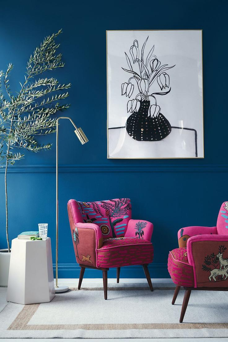 Blue Wall and Pink Embroidered Chairs Colourful Room Decor | Blue is a really versatile colour to decorate your home with. But, which colours and tones work well? What kind of accessories work with blue? This post gives you ideas for pulling together an elegant blue colour palette and pieces for your home. Read more: kittyandb.com #bluewall #colourfulhomedecor #colorpalette ##interiordecoratinginspiration #pinkaesthetic