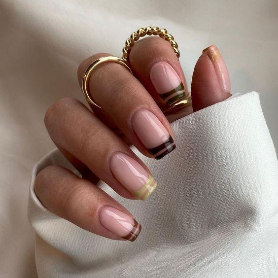 Tonal Brown Neutral Stripe French Manicure | We love a classic French manicure, it's elegant and timeless. But, we also love classic with a twist. Here are all the alternative French manicure styles you need | www.kittyandb.com #Brown #BrownNails #NailArt #French #Tip #FrenchManicure #Nails #Stripes