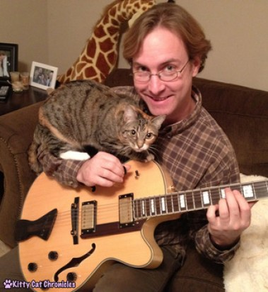 Adopt-a-Shelter-Cat Month: 12 Reasons to Adopt a Cat! - Cat Playing Guitar