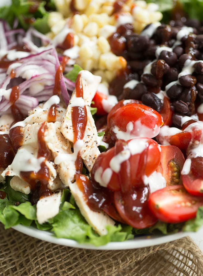 Clean-Eating Barbecue Chicken Salad made with homemade ranch and barbecue sauce. It's fresh, healthy and a simple meal to throw together!