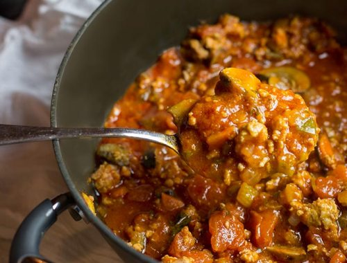 Hide-Your-Veggies Spaghetti Sauce is a simple twist on traditional sauce, combining spicy Italian sausage with veggies in a fragrant tomato base.