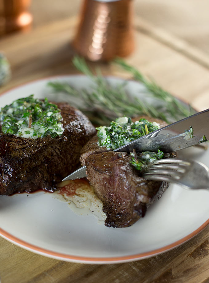 Steakhouse Filet Mignon - a juicy steak that is seared to perfection, served piping hot from the oven and topped with melting bleu cheese and herb butter.