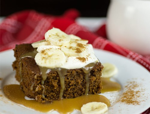 Decadent Gingerbread Cake with Caramel Sauce combines molasses, ginger, smooth caramel, bananas and whipped cream for a luscious, easy-to-make holiday treat.