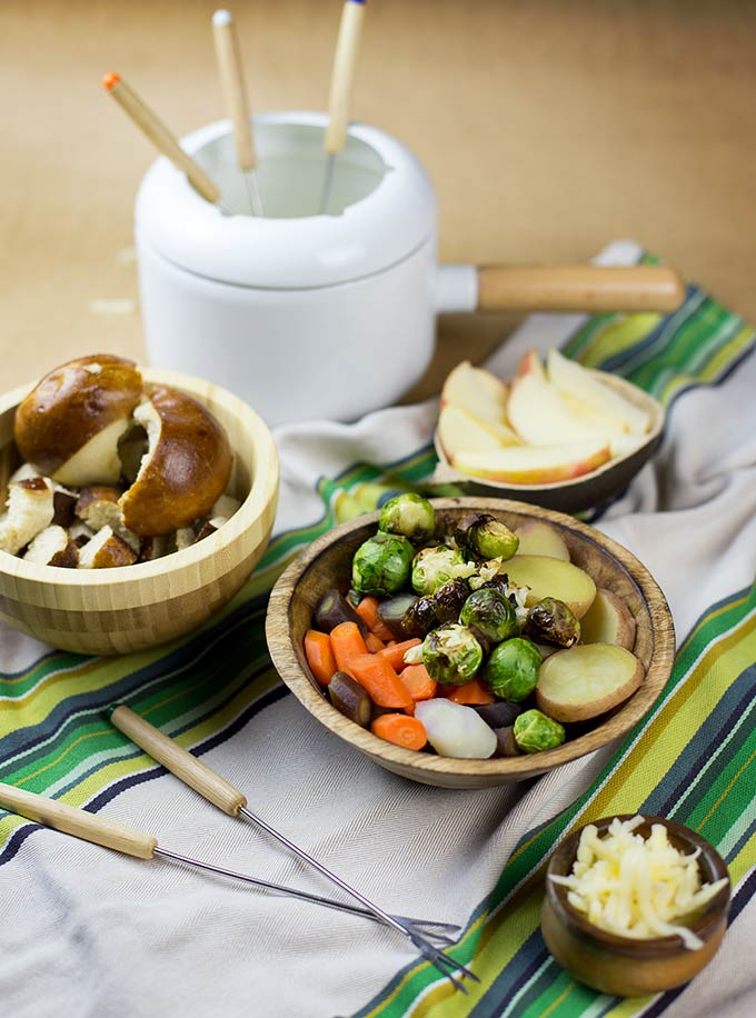 Turn the bold taste of Gruyere cheese into a silky pot of goodness with very little effort! Simple Cheese Fondue with bread, fruit and veggies...YUM!