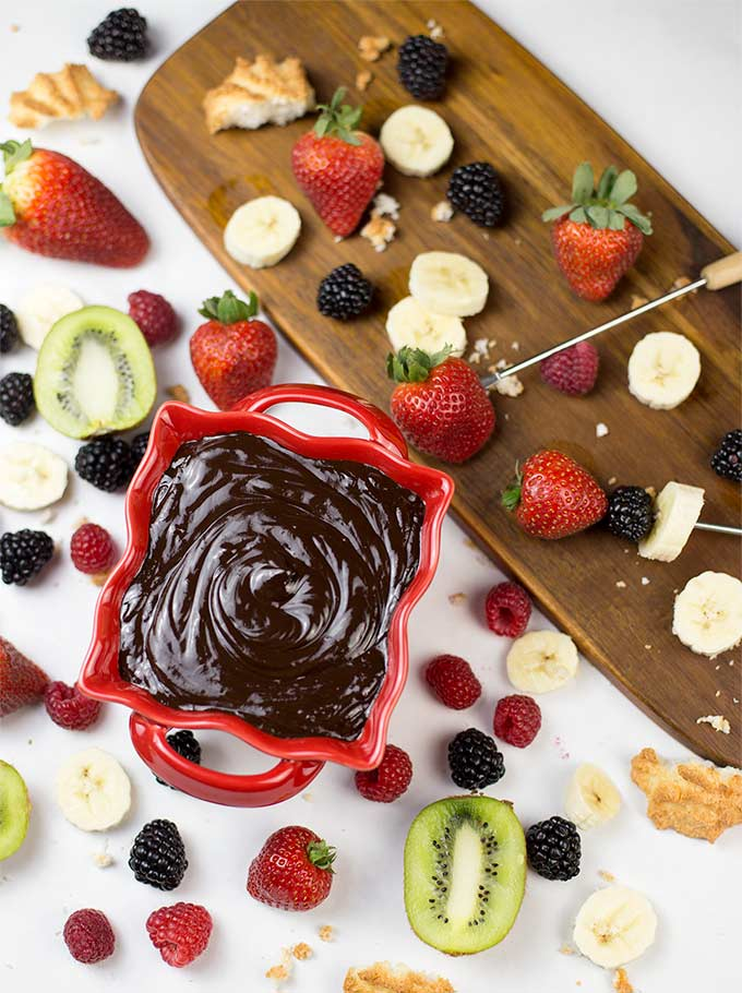 This Chocolate Fondue recipe combines rich chocolate with cream and vanilla for a silky, smooth fondue ready for dipping berries, fruit or cookies.