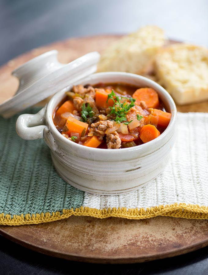 Happily eat your veggies with this yummy one-pot Minestrone Soup! It can be whipped up super fast, freezes well and makes enough for a crowd.