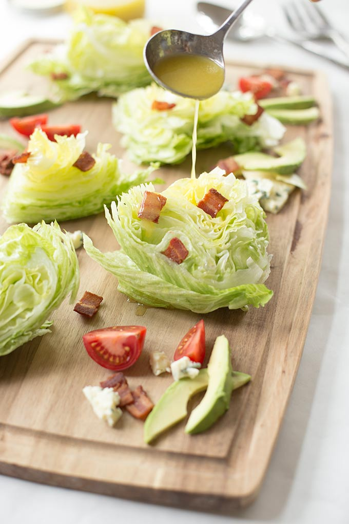 BLT Wedge Salad - a new version of the iceberg classic, with bacon, tomatoes, bleu cheese and avocados drizzled with an Apple Cider vinaigrette.