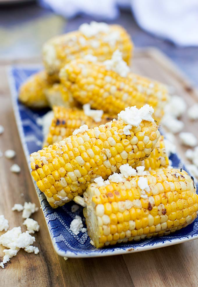This Chili and Lime Grilled Corn combines fresh corn on the cob with spices, herbs, lime and feta cheese for a delicious summer side dish.