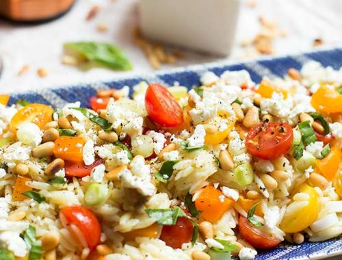 Lemon-Orzo Pasta Salad - Toss some orzo with fresh tomatoes and peppers, and add a little feta and some pine nuts for the perfect picnic side dish!