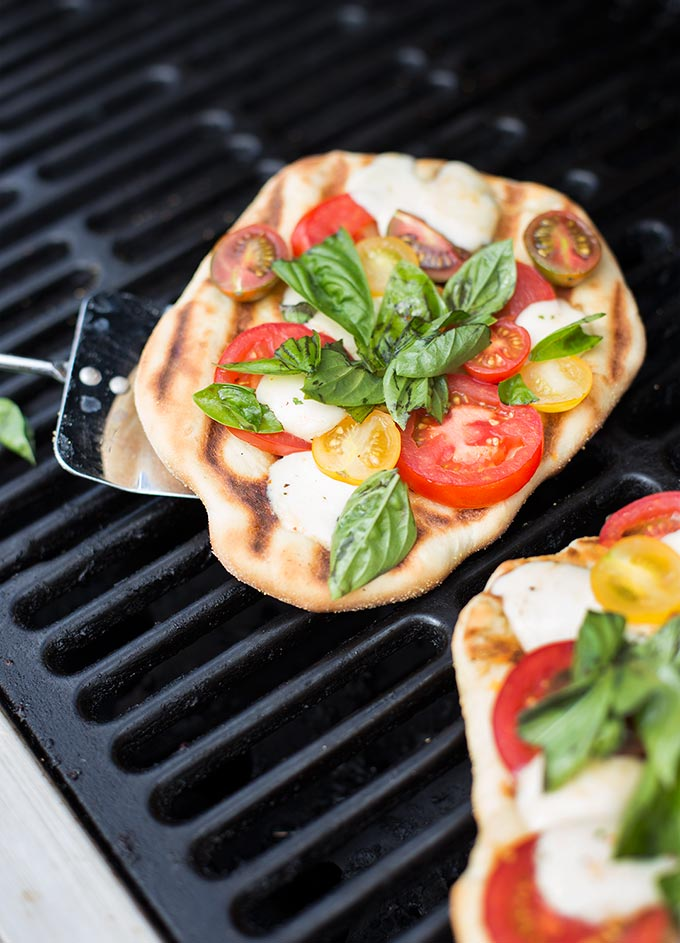 Grilled Margherita Pizza - a fresh and delicious recipe combining mozzarella cheese, fresh basil and garden tomatoes on a garlic and olive oil-brushed crust.