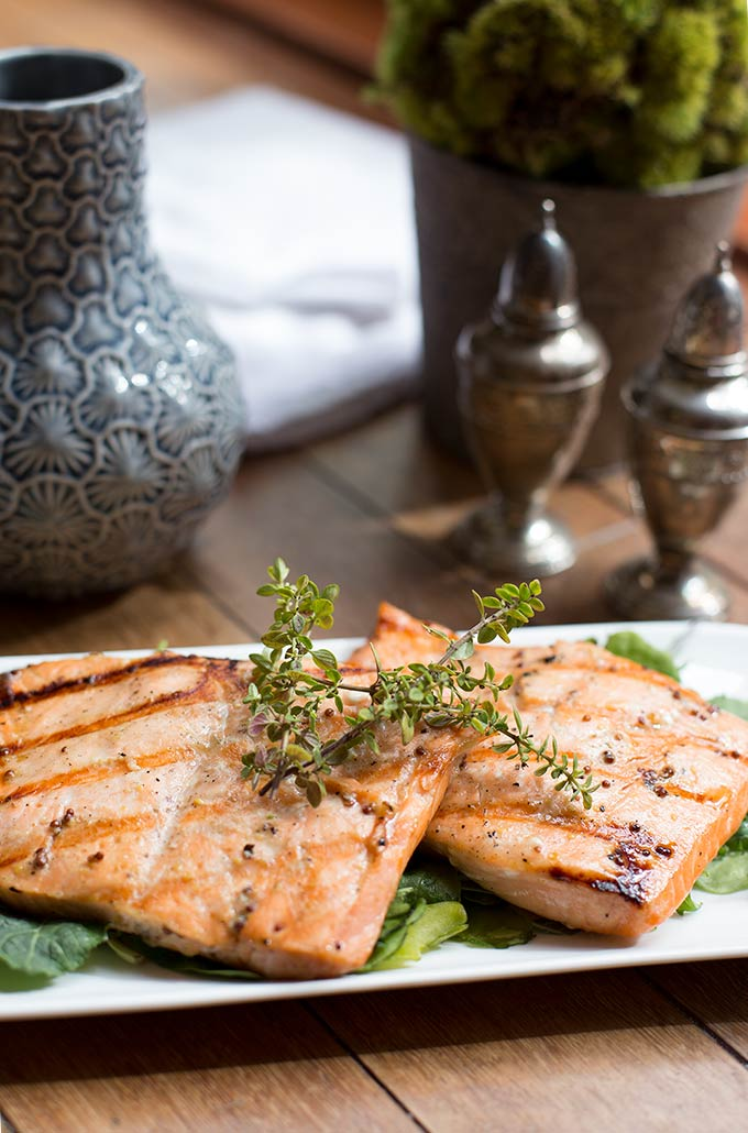 Grilled Maple-Mustard Salmon only takes 5 simple ingredients to make. Sweetened slightly with pure maple syrup and grilled to perfection.