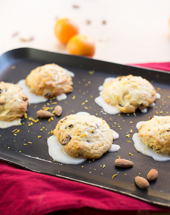 Cranberry Almond Protein Scones - a sweet treat packed with dried cranberries, protein powder and orange zest, drizzled with an almond glaze.