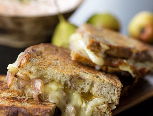 This Gourmet Grilled Cheese Sandwich is loaded with brie cheese, white cheddar and balsamic-sauteed shallots. Smeared with fig jam and honey-mustard butter.