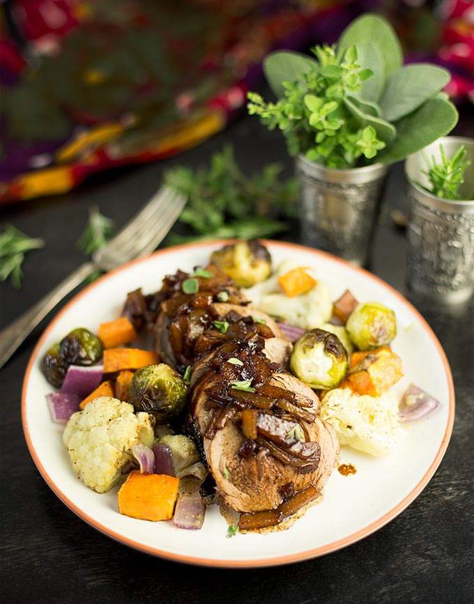 Cumin-Roasted Pork Tenderloin - moist, flavorful pork drizzled with a balsamic glaze. Throw a few veggies in the pan too, and you've got DINNER!