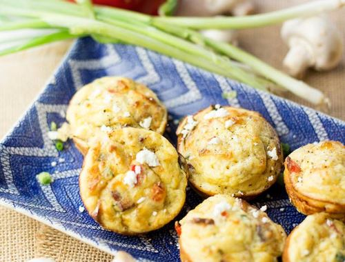Healthify the traditional muffin with Frittata Muffins! Eggs, zucchini, mushrooms and peppers loaded into a muffin tin...the perfect grab and go breakfast!
